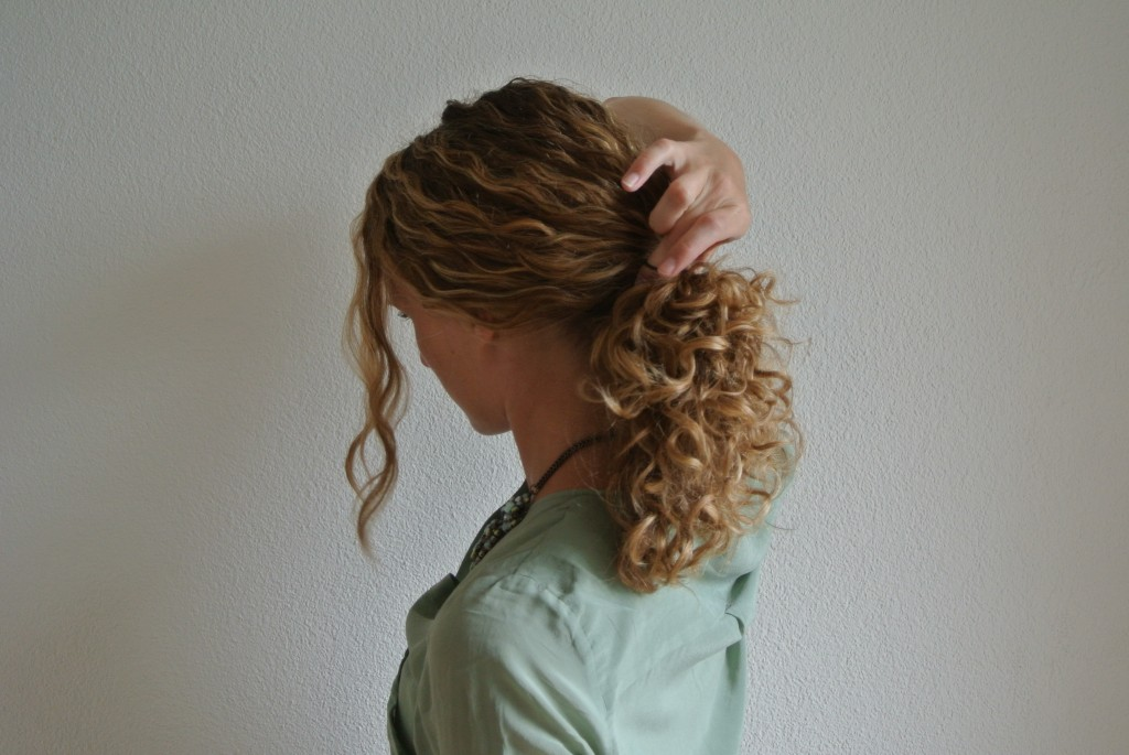1. Style your hair into a ponytail – ust a thin hair tie and make sure not to make your ponytail too tight as you don't want to destroy your curls