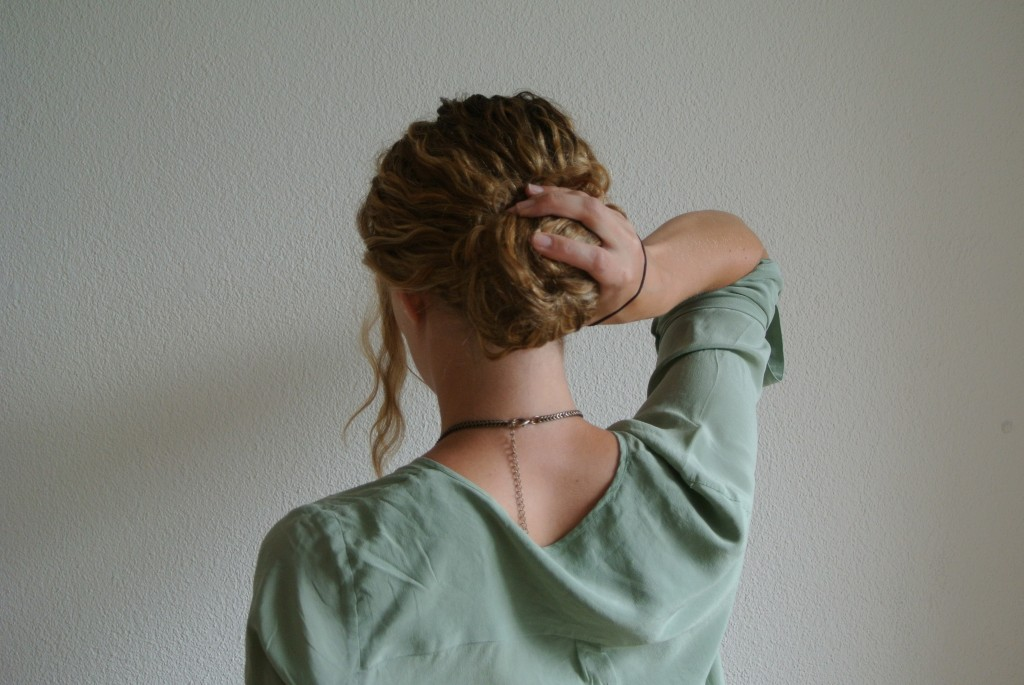 3. Wrap your hair around the doughnut. I like to kind of twist my hair around it and then make sure the doughnut is invisible