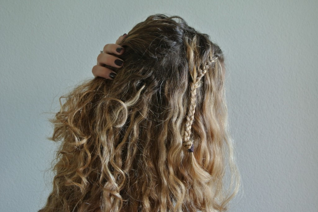 4. Move the curls right behind the braid apart as to be able to fix the braid underneath it.