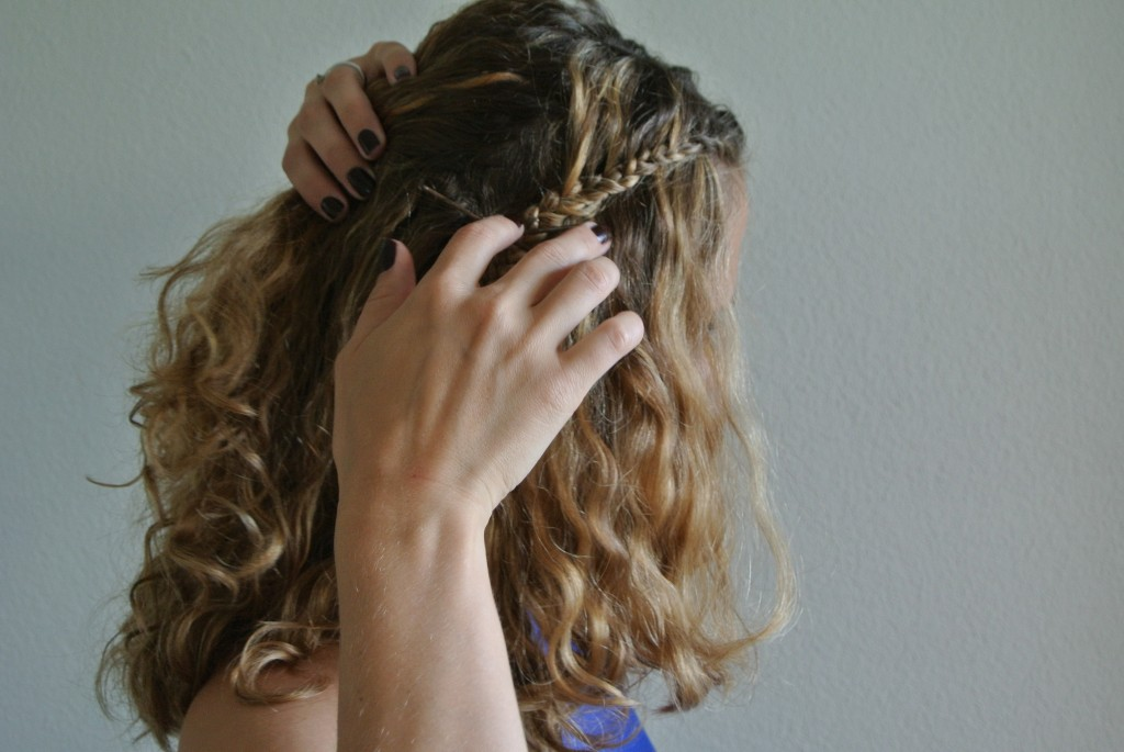5. Remove the hair tie from the braid and then take 2-3 bobby pins to fix the braid underneath your back hair.