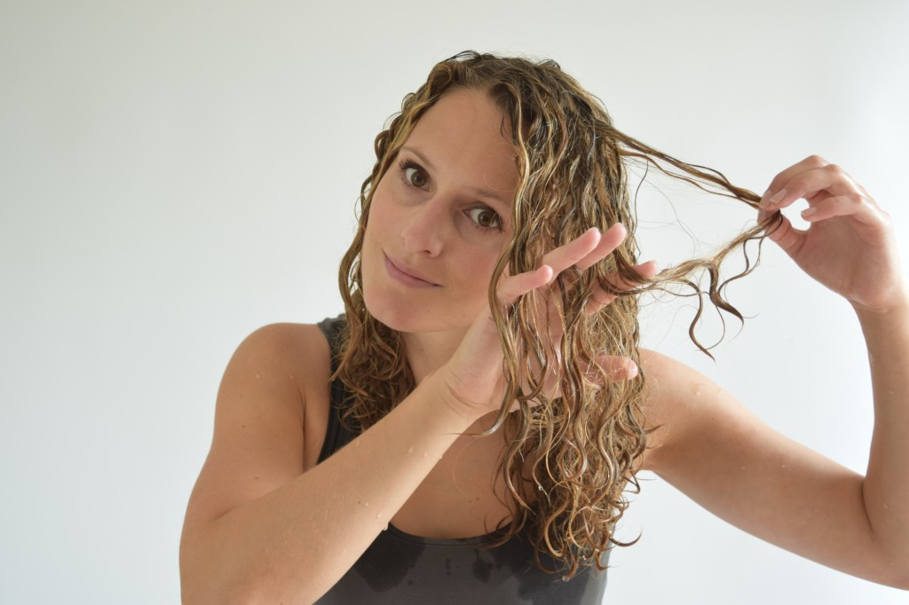 5. To get the knot to disappear separate the two hair strand up to the ends.
