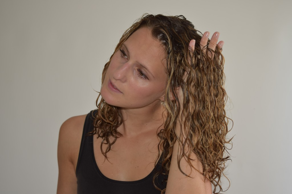 7. When you've detangled the ends of your curls move on to the upper part and continue combing (the same way as before)