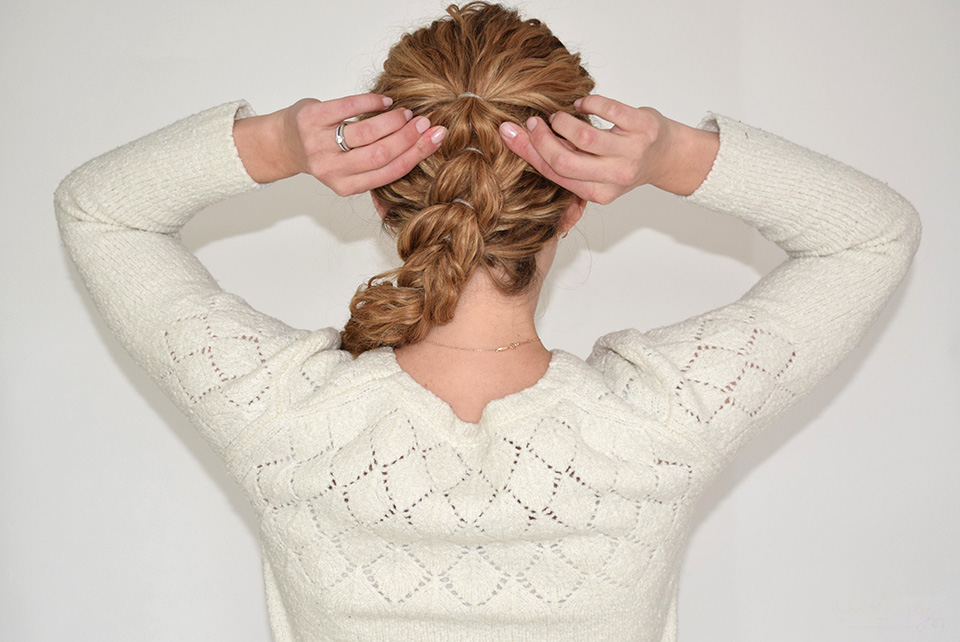 14. To finish this hairstyle, gently pull on the braid to make it look bigger.
