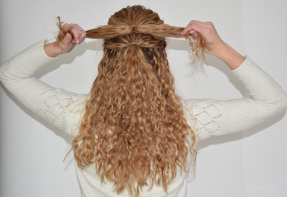 4. Then, separate the upper ponytail into two equally big sections: a right and a left section.