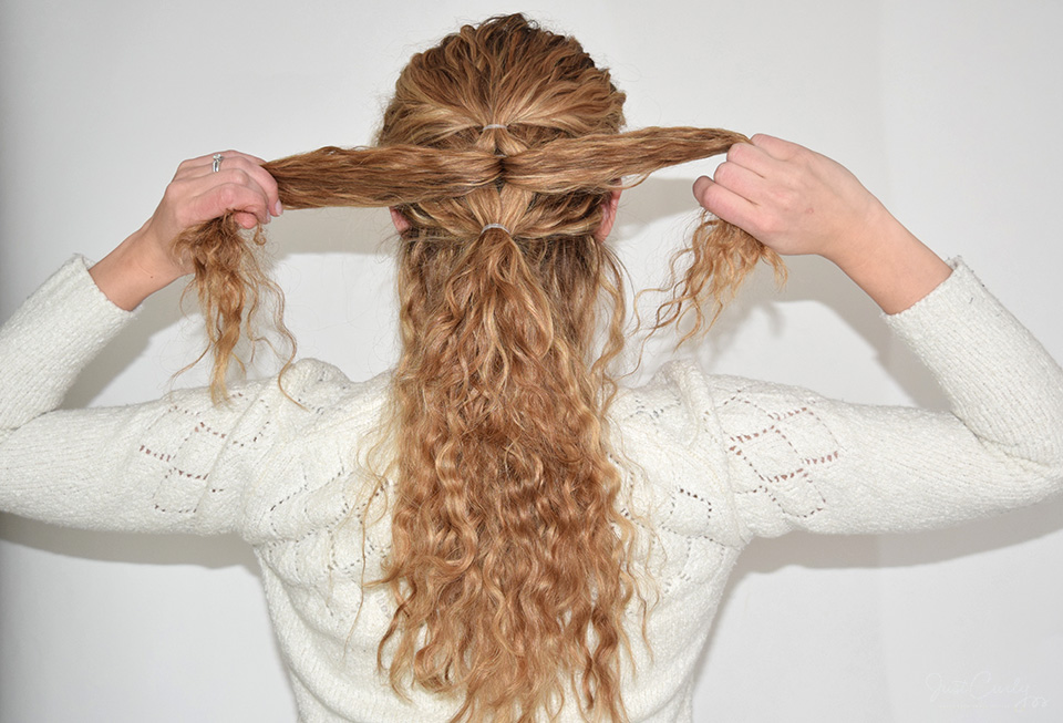 8. Release the now upper ponytail and split it into two equally big sections (like in step 4.).